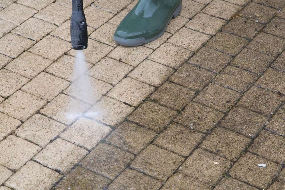 Pressure washing concrete surface